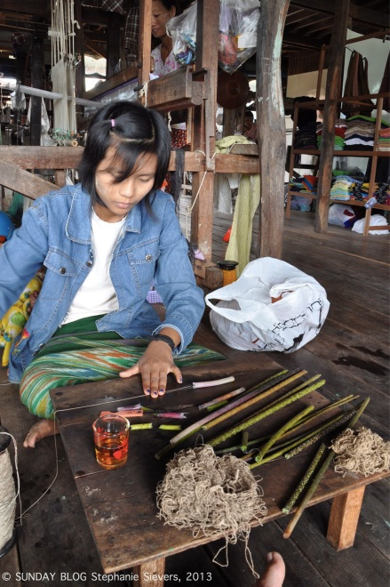 Girl making lotus strings, Myanmar