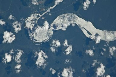 Wide Iguazu River crashing turning and crashing down to form the