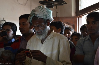 Men testing a solar lamp for the first time