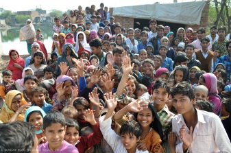 Kids in the village waving goodbye