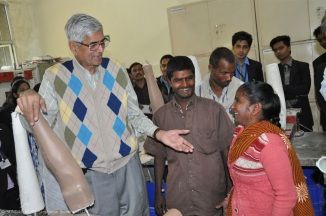 Mr. Metha talking to patient